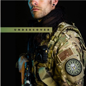 Man in combat gear and gun with text that reads 'undercover'