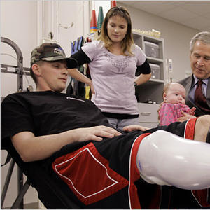 """A photo of President Bush visiting a resident at Walter Reed. Accompanying Peter Baker's Washington Post article titled, """"At Walter Reed, Bush Offers an Apology."""""""