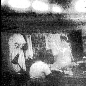 Photo of reporter Merle Linda Wolin in a garment manufacturing shop.